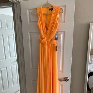 Long Lulus dress in orange.